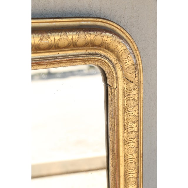 This antique French mirror features a wonderful carved, gilt frame with a gorgeous nouveau pattern. The inter-locked...