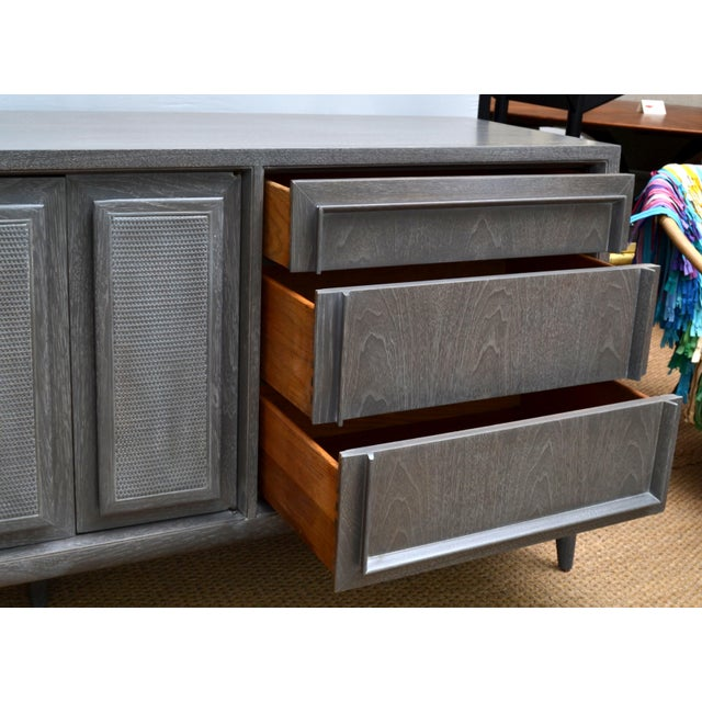 A mid-20th century modern credenza manufactured by Century Furniture of Distinction, circa 1960. Long and sleek measuring...