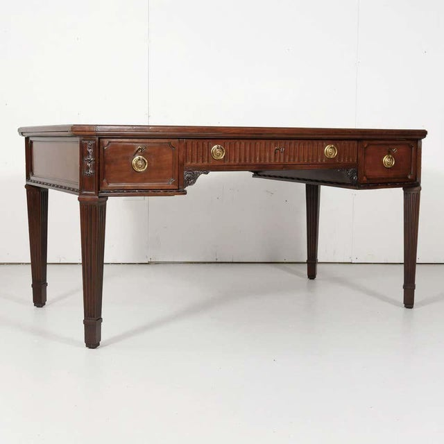 A fine 19th century French Louis XVI style bureau plat handcrafted of solid walnut by talented artisans in Lyon for the...