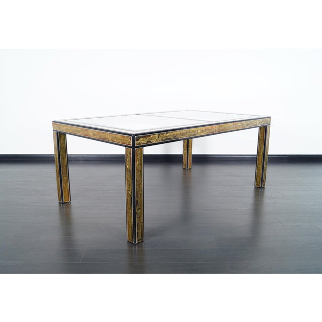 This stunning dining table was designed by Bernhard Rohne for Mastercraft. Features a unique acid etched brass design...