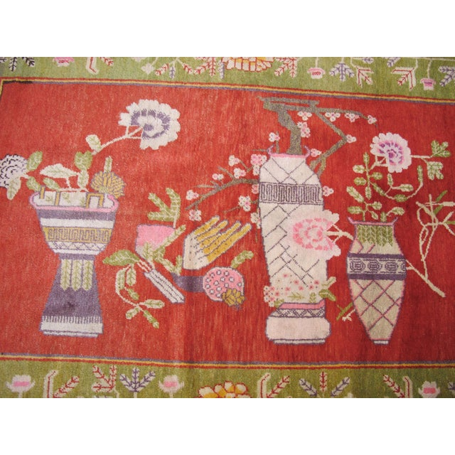 This colorful pictorial rug was woven in the Tarim Basin region of East Turkestan, the western most part of China...