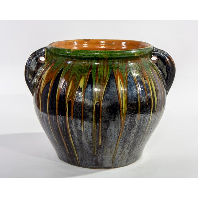 Large red ware ceramic mid century glazed hand thrown pot with black base and green/yellow/red drip embellishment. Found...