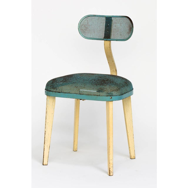 Industrial style chair in blue and beige enameled steel in the manner of Jean Prouve. Adjustable back and wood legs.