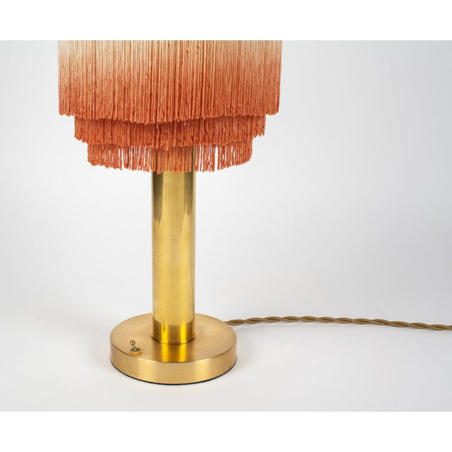 "Hand made brass and fringe table lamp 8"" hand dyed fringe (Slight color variation might occur) Dimensions: H 21"" x W 9.5""..."