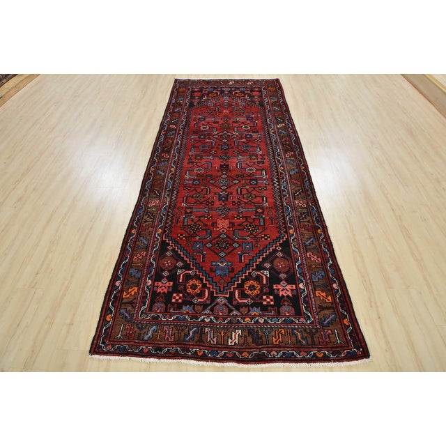 This is an authentic vintage Persian Hamadan rug hand-knotted in Persia with an all wool pile with abrash on a cotton...