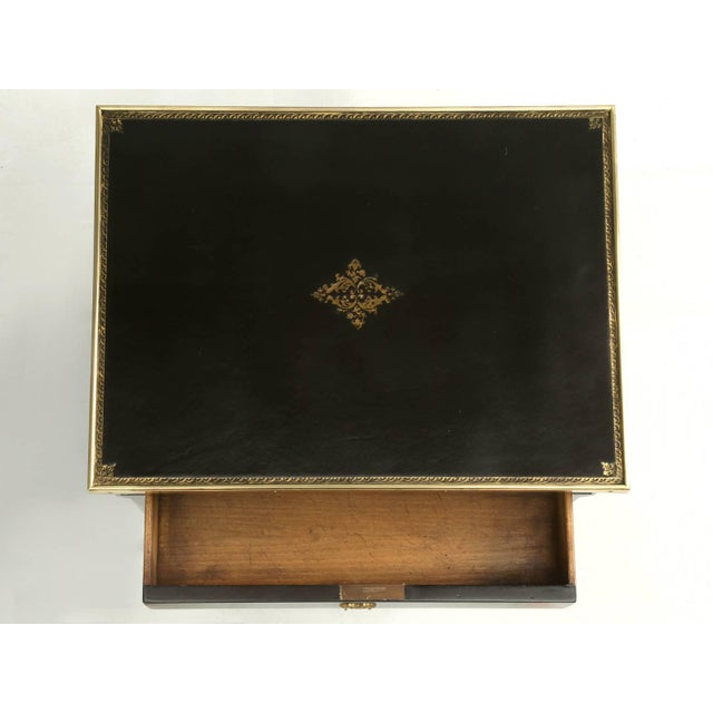 Beautiful petite antique French end or side table, in the style of Louis XVI. The drawer is hand dove-tailed and the...