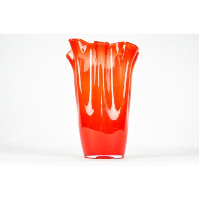 Mid-Century Modern orange Murano glass vase with ruffled rim.