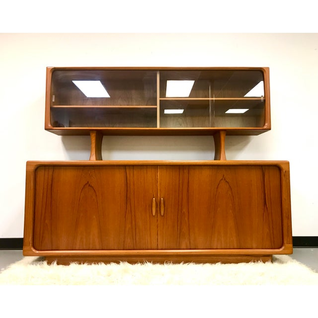 Vintage Danish modern teak tambour door sideboard with hutch by Dyrlund. The wood grain on this piece is exceptional and...