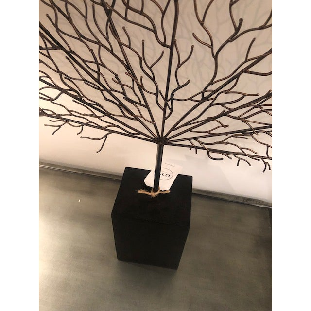 Black and bronze tinted metal coral piece, with a ebonized block base.