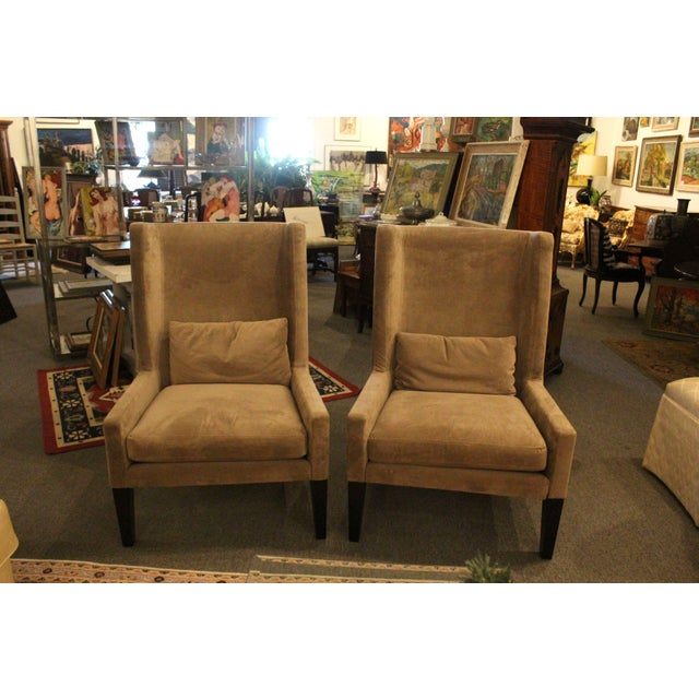 Gray upholstered high-back contemporary wing chairs. Comes with plush lumbar supporting pillows. Very comfy.