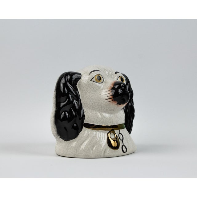 Antique Staffordshire dog head bank. Circa early 1900's. Made out of ceramic. Beautifully hand painted with attention to...