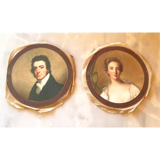 Antique style round portraits of a stately gentleman and his lady by Park Hill Collection. As of the times, they have a...