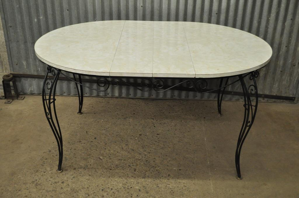 Item Detail: Vintage Mid Century Modern Wrought Iron Patio Dining Set. The  Sets Consists