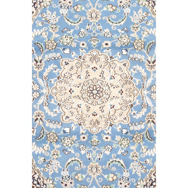 Offered is a hand knotted Nain rug made from wool and silk. From Persia.