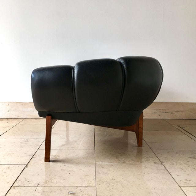 A Rare Black Leather Two Seater Croissant Sofa by Illum Wikkelso for Holger Christiansen, Denmark 1950s In excellent...