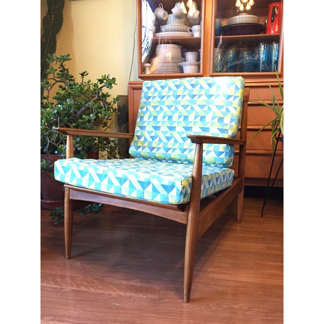 This pretty danish style chair sits low and loungy. It is in good original Condition with evidence of repairs to a few...