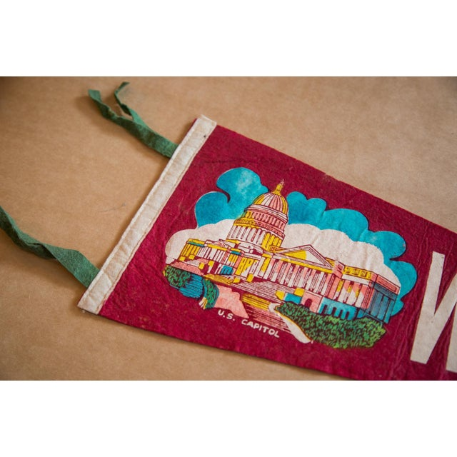 :: 1960s Washington D.C. felt flag banner featuring colorful imagery of the U.S. Capitol. This felt flag pennant is in...
