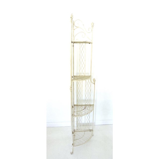 Vintage European style etagere or corner shelf / shelving unit made from cast iron/wrought iron. Folds completely flat for...