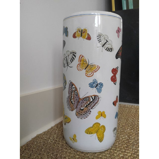 Imbue your foyer with whimsy with this umbrella stand hand painted with butterflies. The pattern is reminiscent of a Piero...