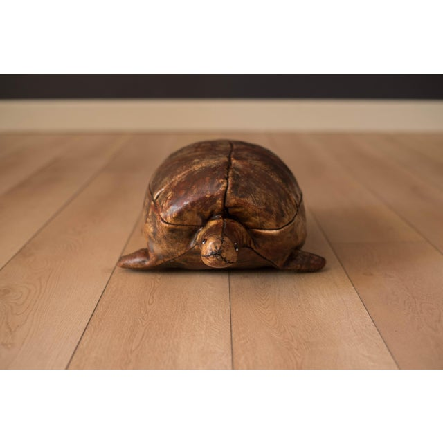 Mid-Century Modern original leather turtle designed by Dimitri Omersa for Abercrombie & Fitch, circa 1960s. This unique...