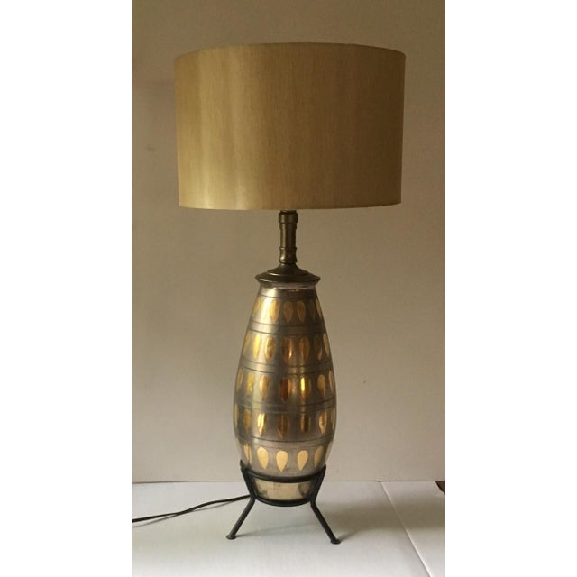 """Up for sale is this gorgeous rocketship of a table lamp, a vintage, mid-century treasure. Standing 31"""" tall with a gold..."""