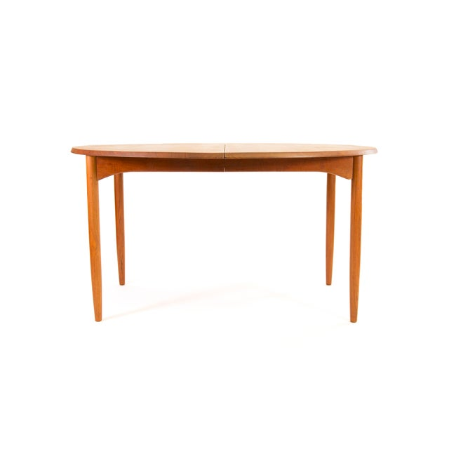 FREE SHIPPING IN THE U.S. Here is a neat Danish solid teak dining table with two leaves. We acquired this table from the...