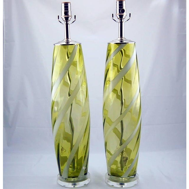 Vintage Italian glass table lamps in CHARTREUSE with a ribbon of WHITE swirling up and around. We have them paired with...