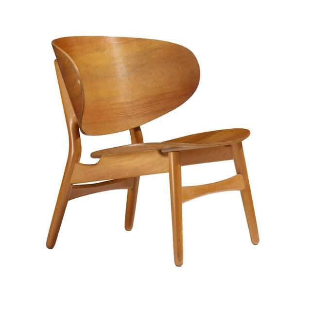 Danish lounge chair designed by Hans Wegner for Fritz Hansen. Teak shell back and seat on a beech frame.