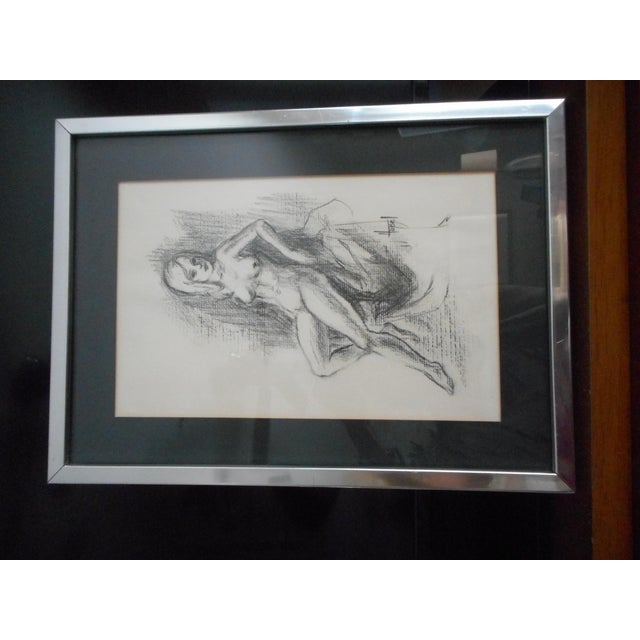 A lovely charcoal nude from the 1970's. Signed. Glass Original chrome frame matted and wired to hang.