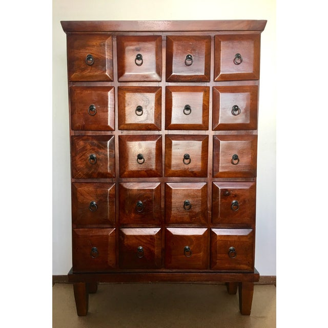Beautiful 20 drawer mahogany wood apothecary cabinet. Rich red mahogany stain & distressed-worn appearance. Dings,...