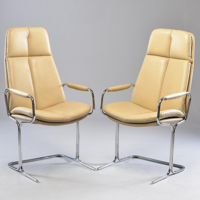 Circa 1970s pair of armchairs designed by Tim Bates for the Eleganza collection at Pieff. Frames are made of tubular metal...