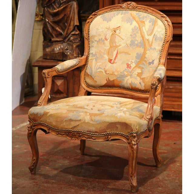 This elegant, antique fruitwood armchair was crafted in Lyon, France circa 1860. The chair has beautiful cabriole legs,...
