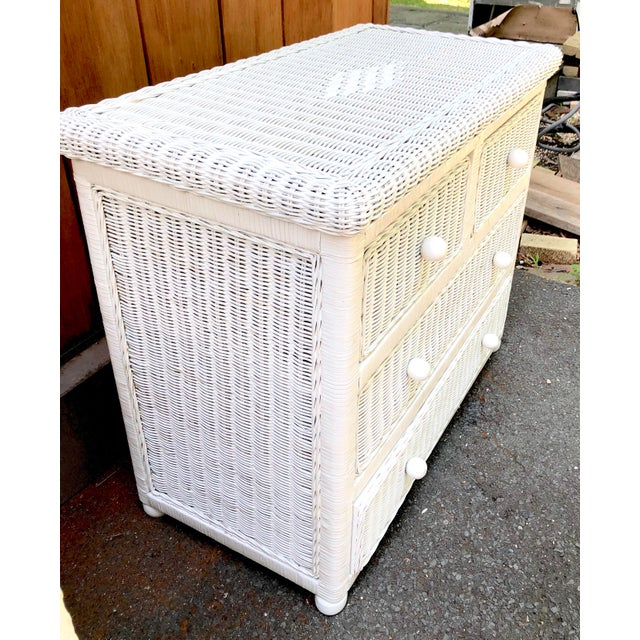 White wicker five drawer dresser with diamond shape on top. Drawers slide smoothly classic, charming and nicely sized. It...