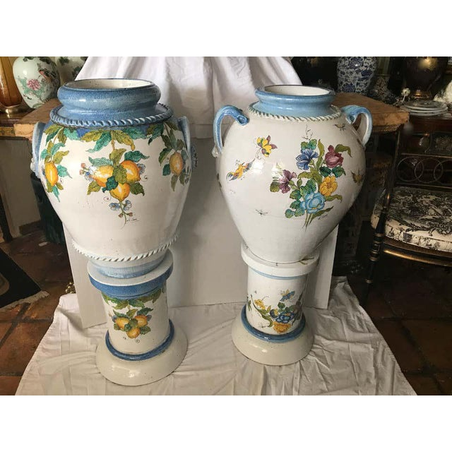 Dramatic in scale: Hand painted urns - superbly fashioned in the Tuscan style - signed La Chimera. The pair with urn form...