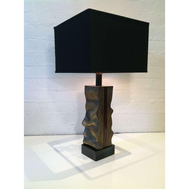 A wonderful sculptural bronze table lamp with a black lacquer by Del Campo signed and dated 1979