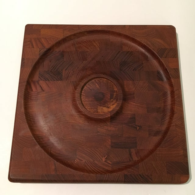 A mid-century teakwood serving tray by Kalmar Designs. Made in Denmark. Also included in the sale is a glass bowl to hold...