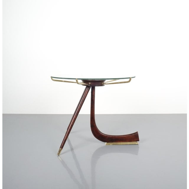 Brevettato Wood Brass Coffee or Side Table, Italy 1955. Unusually shaped wooden table with brass details and wooden...