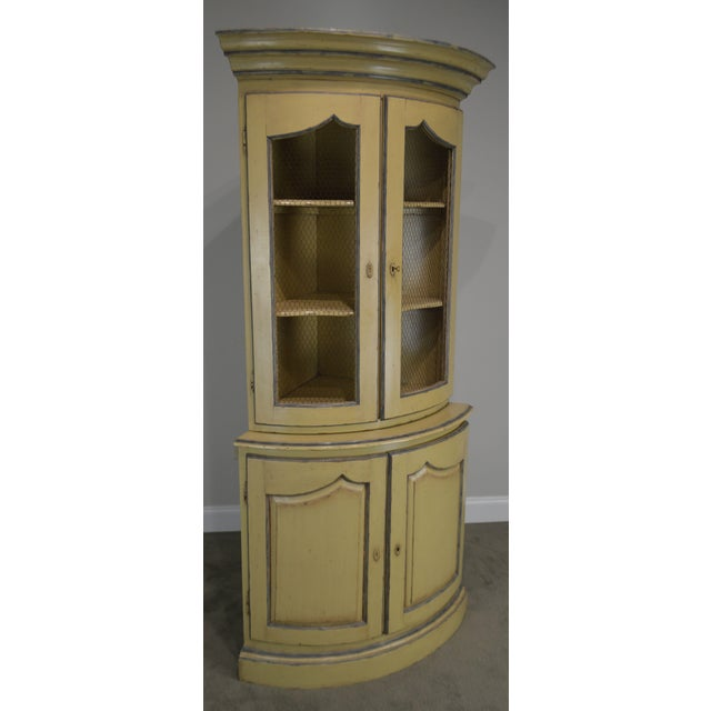 High quality distressed painted 2-piece corner cabinet with wire mesh doors.~ Unsigned maker, possibly 'Grange'.