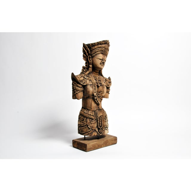 Recently carved from a reclaimed piece of teak wood, this bust takes the form of an Apsara. Traditionally found in Hindu...