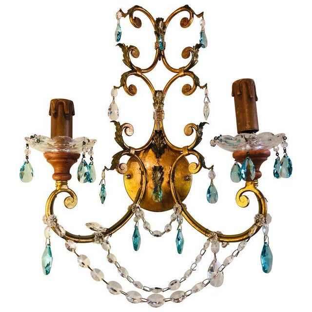 A pair of neoclassical handcrafted Italian gilt metal and crystal sconces Neoclassical handcrafted Italian gilt metal and...