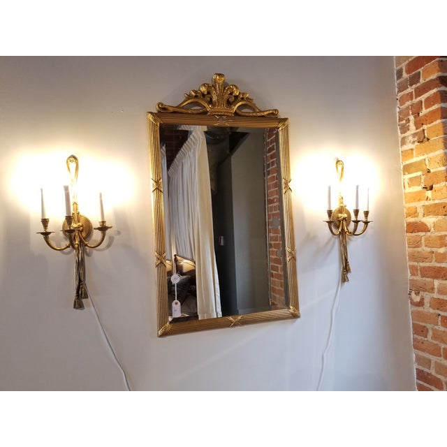 French Style cast brass 3 arm ribbon sconces from the hallways of the Towers Suites of the famed Waldorf Astoria hotel in...