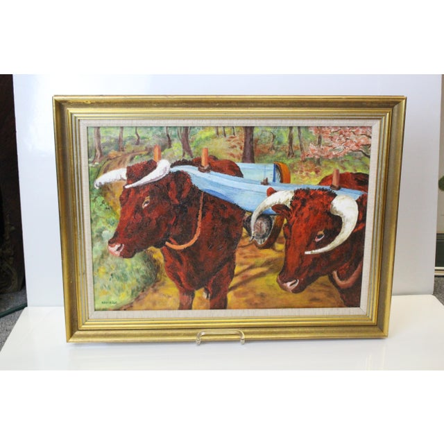 Perfect for the farmhouse - Oil on canvas red-brown oxen in green landscape background. In sturdy gilt frame.