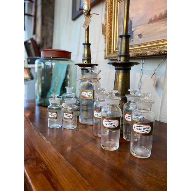 Late 1800's Set of 8 Apothecary Jars with lids. (two lids are missing) Great condition. No wear on labels, no chips or...