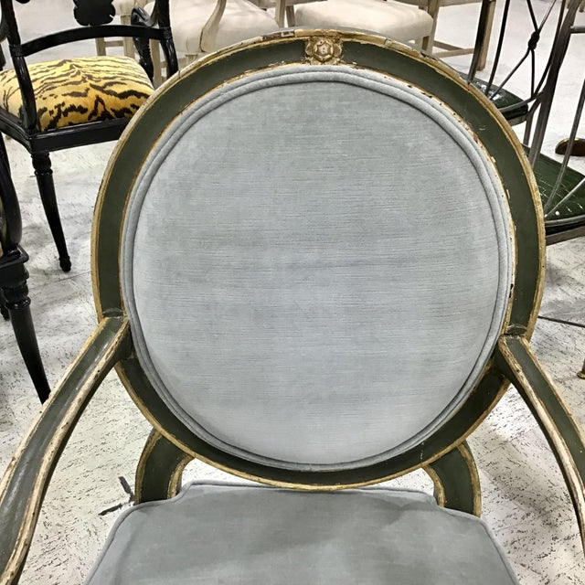 Pair of 18th Century Italian Neoclassic Armchairs. Original painted and gilt wood surface with old patina. Fluted legs....