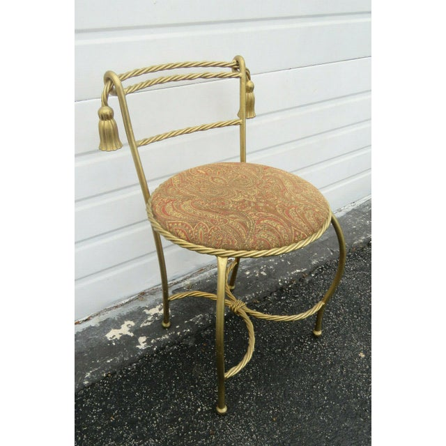 This gorgeous Chair or Stool is made of metal and fabric. This wonderful vanity chair is an incredible example of the...