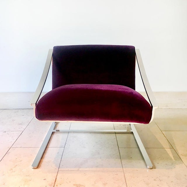 Single Polished Steel Cantilevered Chair designed by Charles Gibilterra for Brueton reupholstered in a rich plum velvet by...