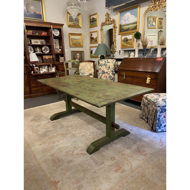 This antique farm table is in excellent condition. It was painted many years ago, so the paint is now vintage and...