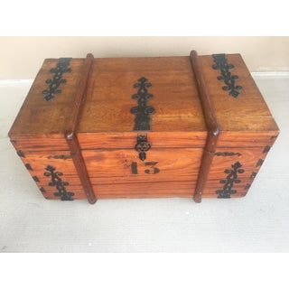 Rustic Antique Trunk With Metal Accents Preview