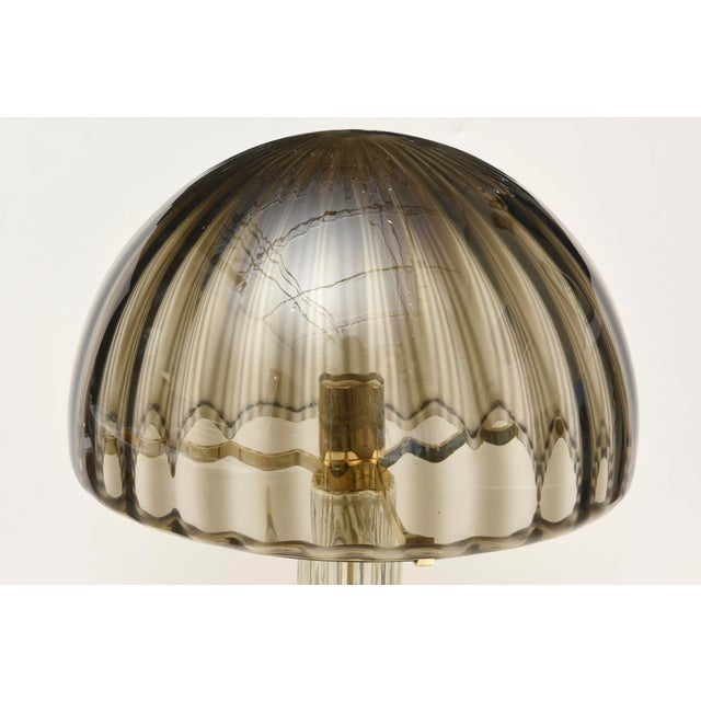 The ribbed glass in shades of gradients of gray/champagne/charcoal in dome form of this Italian vintage Murano dome...