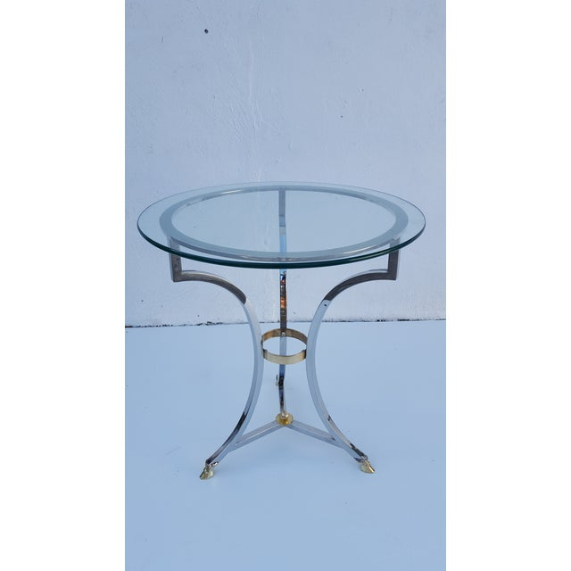 Mid-century modern French Maison Jansen chrome and brass side table . Item features tripod frame , solid brass polished...